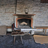Dirty fireplace in abandoned interior Stock Photography