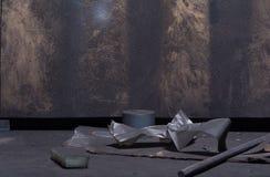 Dirty floor with different sort of garbage. Dirty floor with some sort of garbage. Black sponge with piece of sawdust door lying on the floor of workshop studio royalty free stock photo
