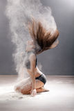 Dirty in flour dancer posing on a studio background Stock Photography