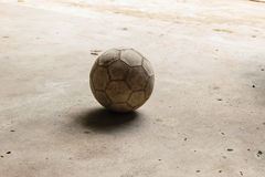 Dirty football. On cement floor, cement floor background Royalty Free Stock Photography