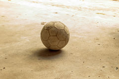 Dirty football. On cement floor, cement floor background Stock Photography