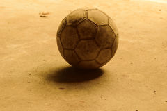 Dirty football. On cement floor, cement floor background, concept white black image Royalty Free Stock Photography