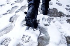 Free Dirty Footprints In The Snow Winter. Track From Boots On The Trail. Cold Weather And Slush. Wet Feet And Shoes Walk. Stock Image - 104244661