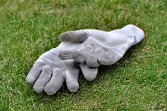 Dirty gardening gloves Stock Photos