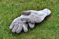 Dirty gardening gloves Stock Photos