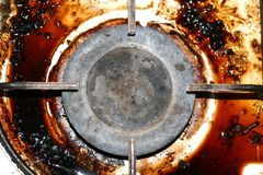 Dirty gas stove. The gas burner. Fat, rust on the surface. Stock Image