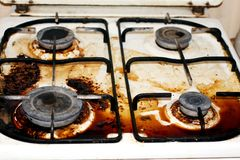 Dirty gas stove. Fat, rust on the surface. Royalty Free Stock Images