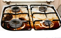 Dirty gas stove. Fat, rust on the surface. Stock Images