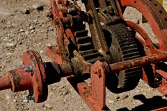 Dirty gears and cogs. Gears and cogs of an outdoor saw for cutting logs royalty free stock images