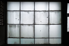 Dirty glass wall. Old and dirty glass wall inside old building Stock Photo