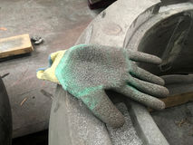 Dirty glove. One side on the job Stock Image