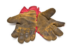 Dirty gloves. On the isolated background Royalty Free Stock Image