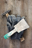 Dirty gloves and tools Royalty Free Stock Photography