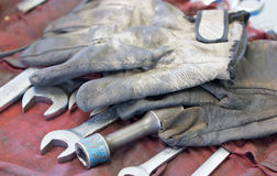 Dirty Gloves And Wrenches. Stock Photography