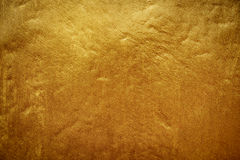 Dirty golden concrete texture Stock Image