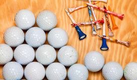 Dirty golf balls and tees. On wood Royalty Free Stock Image