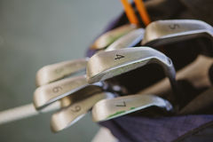 Dirty golf clubs. In bag. Shallow dof Royalty Free Stock Images