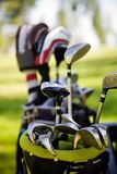 Dirty golfclubs. Dirty golf clubs in buggy, selective focus Stock Images