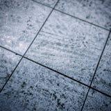 Dirty gray floor tiles stock photo