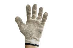 Dirty gray glove. Hand with dirty gray glove on white background royalty free stock photography