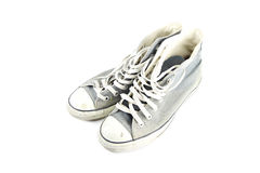 Dirty gray sneaker isolated. Stock Photography