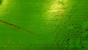 Dirty green painted surface. Isolated closeup of green surface, wood painted green with marks and scuffs Stock Photography