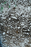 Dirty grey concrete wall with colored stones 1 Royalty Free Stock Image