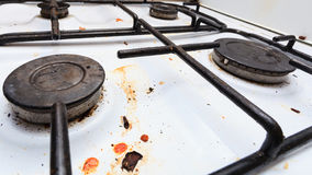 Dirty grubby gas stove in kitchen Royalty Free Stock Photo