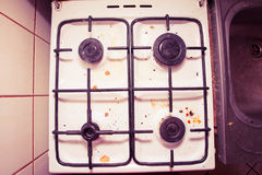 Dirty grubby gas stove in kitchen Stock Photos
