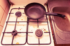 Dirty grubby gas stove in kitchen Stock Photography