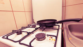 Dirty grubby gas stove in kitchen Stock Images