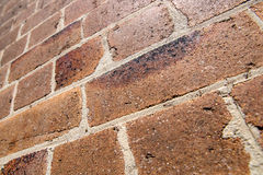 Dirty grungy orange brick wall upwards perspective in Sydney Stock Photo