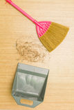 Dirty hair on laminate floor with broom and dustpan. Stock Images