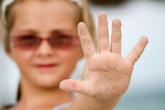 Dirty Hand held up in the stop position Stock Photos