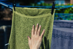 Dirty hand touching clean laundry Royalty Free Stock Images