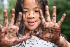 Dirty hands. Close up of child  showing two dirty hands Royalty Free Stock Photo