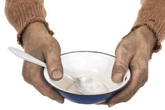 Dirty hands with bowl. Poor man in old sweater with empty bowl Stock Images