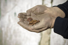 Dirty  hands with coins Royalty Free Stock Photos