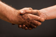 Dirty hands of the country's farmers who shake hands royalty free stock photography