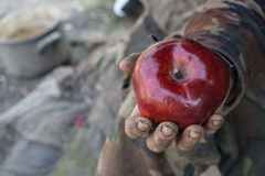 Dirty hands and fresh apple Royalty Free Stock Photo