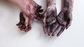 Dirty hands hard woman job emancipation feminism. Two pairs of dirty woman hands on white background. Gender borders erased in modern working sphere stock photography