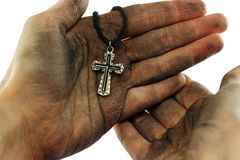 Dirty hands holding cross. On white background Royalty Free Stock Images