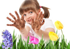 Dirty hands - little girl gardening Stock Images