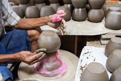 Dirty hands making pottery Royalty Free Stock Images