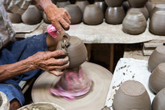 Dirty hands making pottery Stock Image