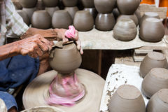 Dirty hands making pottery Stock Photos