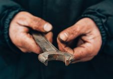 Dirty hands of a man, a working man, a man drained his hands while working, a poor man.  royalty free stock image