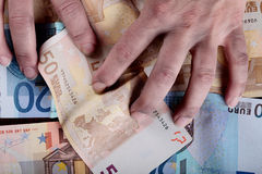 Dirty hands and money Stock Photography
