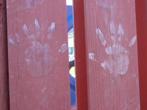 Dirty hands on the Playground. These hands prints were left behind at the local playground Stock Image