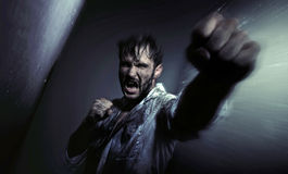 Dirty handsome man fighting for egsistance Royalty Free Stock Photography
